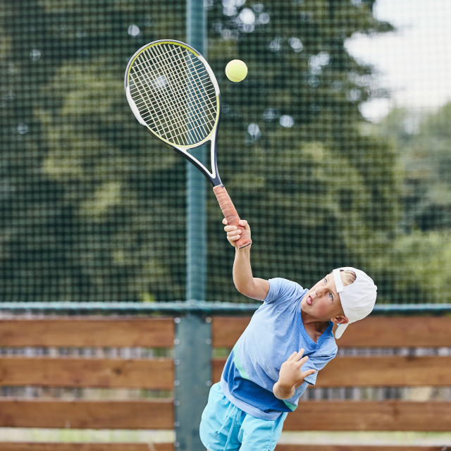 """Little boy playing tennis"" stock image"