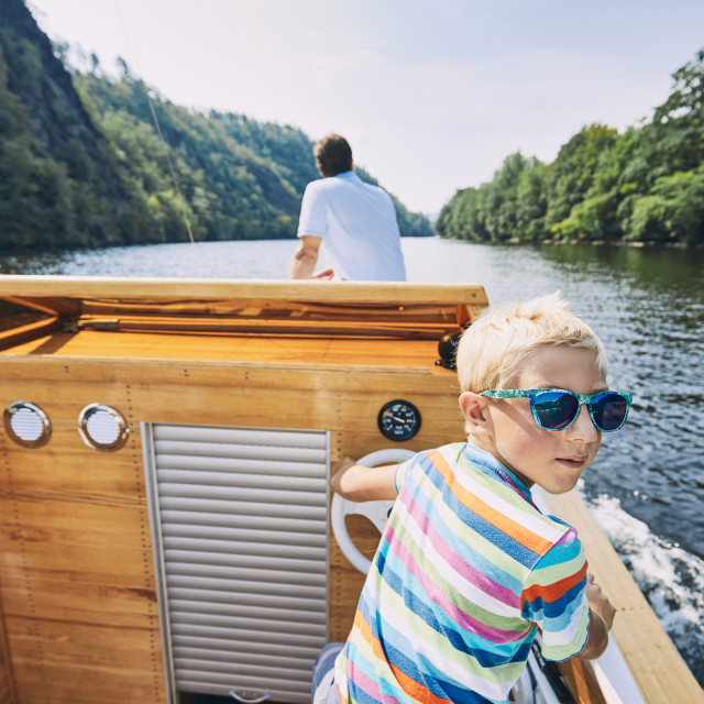 """Boy driving motor boat"" stock image"