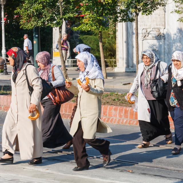 """Muslim women crossing the road i"" stock image"
