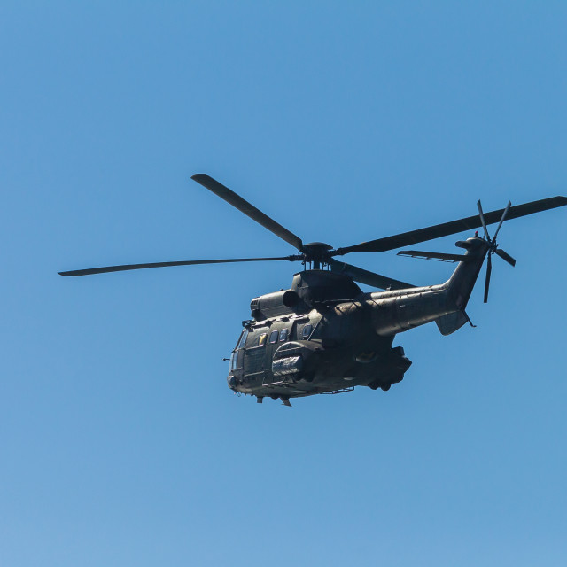 """""""Helicopter Military Flying Blue sky"""" stock image"""