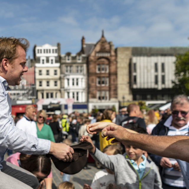 """Street Performer Collecting Money, Edinburgh Festival"" stock image"