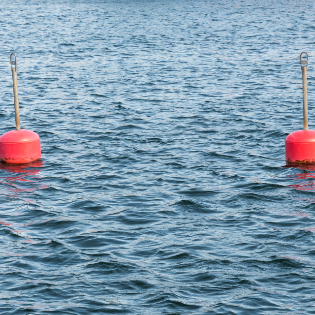 """""""Red anchor buoys in water"""" stock image"""