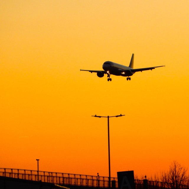 """""""Airliner arriving at sunset"""" stock image"""