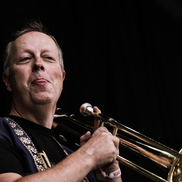 """Smiling Trombone player 2 - Bollywood Brass Band at Mela Festival, Oslo"" stock image"