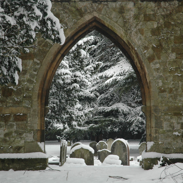 """""""Arch In A Snow Covered Graveyard"""" stock image"""