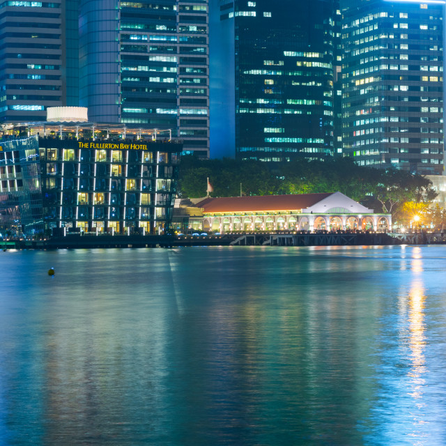 """""""SINGAPORE - 27 Oct 2015: the Fullerton Bay hotel is seen across the Marina..."""" stock image"""