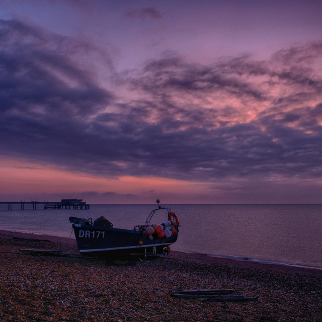 """Deal pier and fishing boat."" stock image"