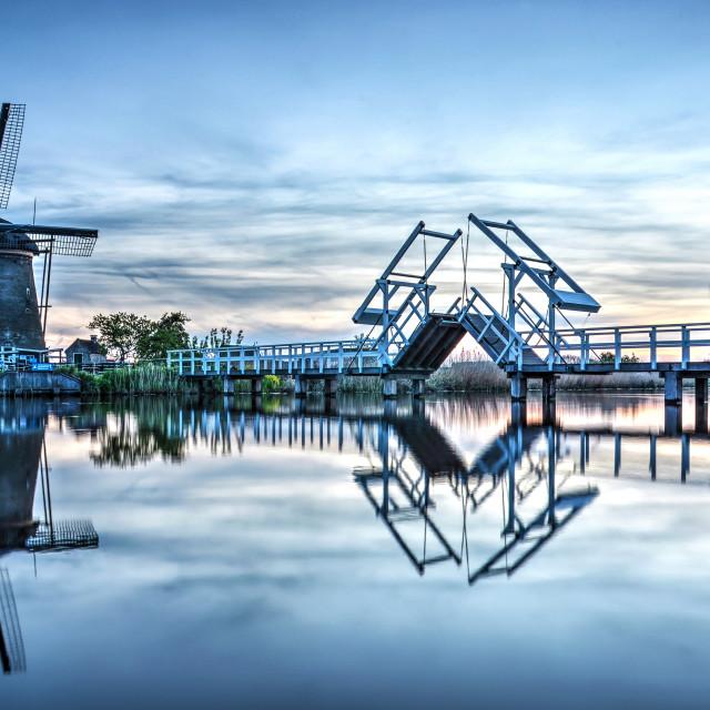 """Reflection of windmills and drawbridge"" stock image"