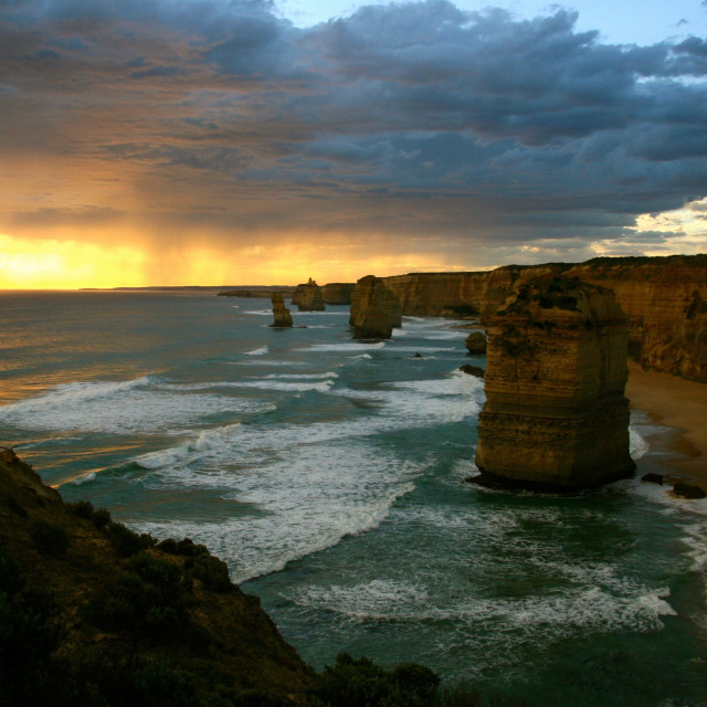 """""""The sun sets of the Twelve Apostles"""" stock image"""