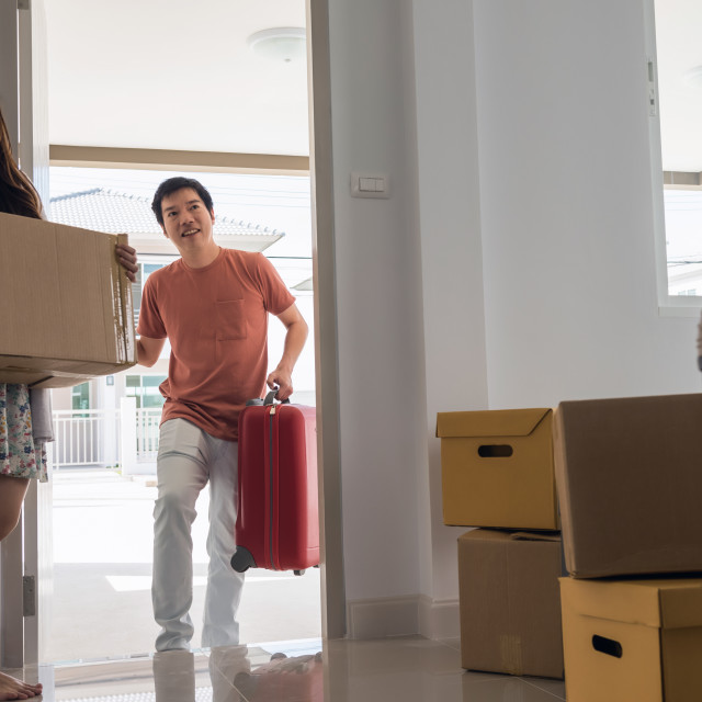 """Asian couple move to new house"" stock image"