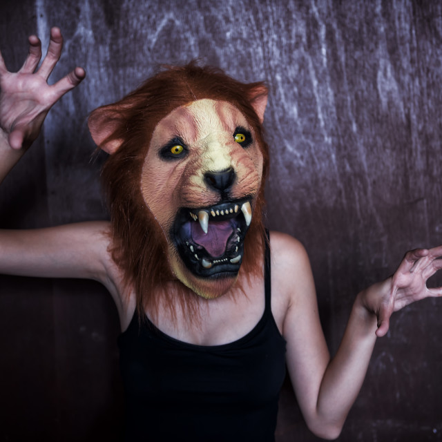 """Woman with Halloween lion mask"" stock image"
