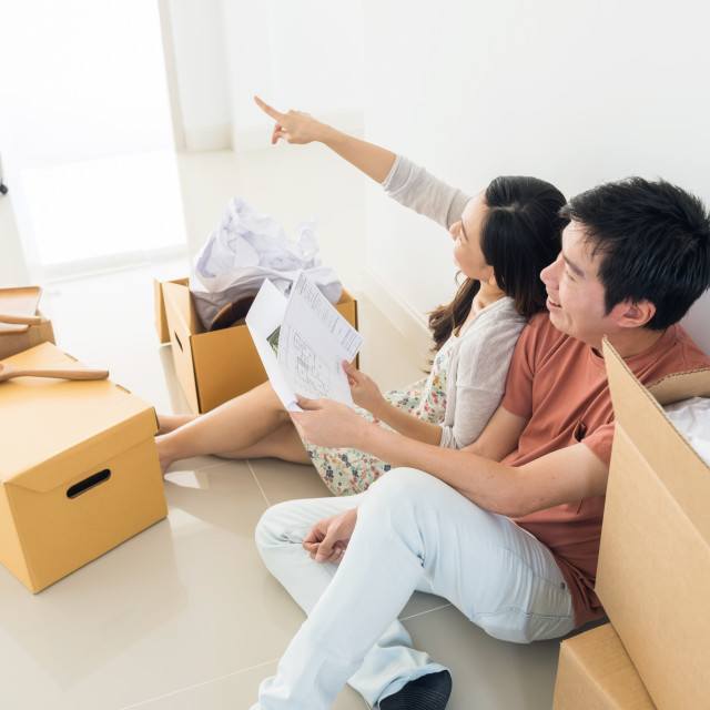 """Happy couple plan interior of new house"" stock image"