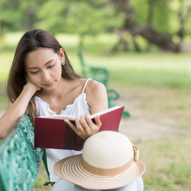 """woman read text in garden"" stock image"