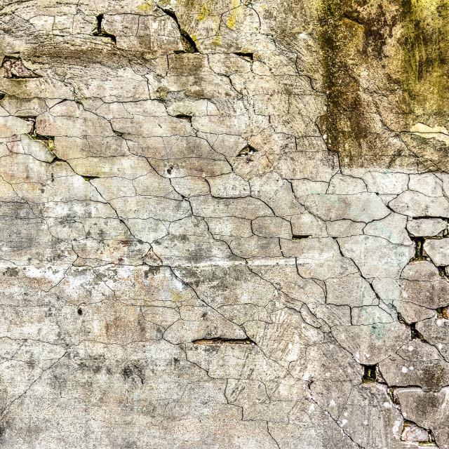 """Plaster wall with diagonal cracks"" stock image"