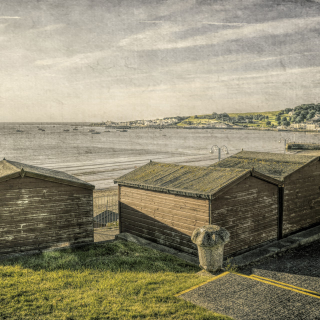 """Swanage Beach huts and the Bay"" stock image"