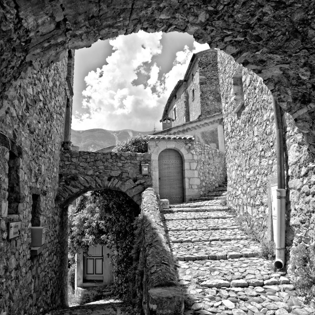 """Cobbles and archways; Brantes village"" stock image"
