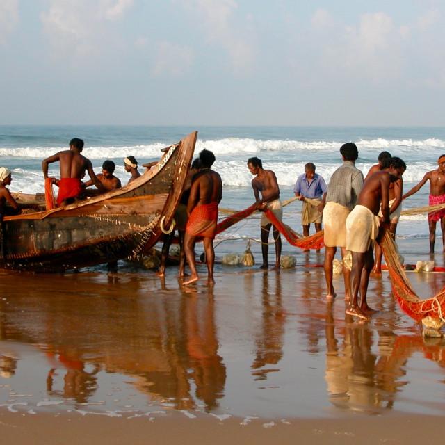 """""""Kerala fishermen prepare a dawn sweep of the ocean"""" stock image"""