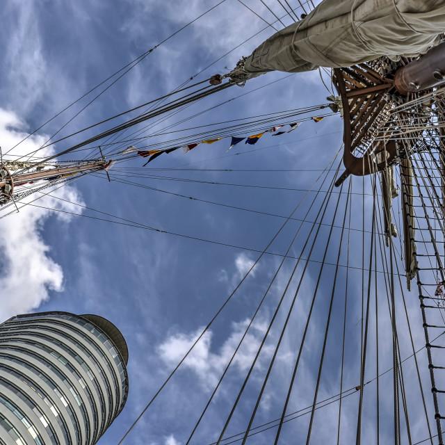 """Sailing ship and World Port Center"" stock image"