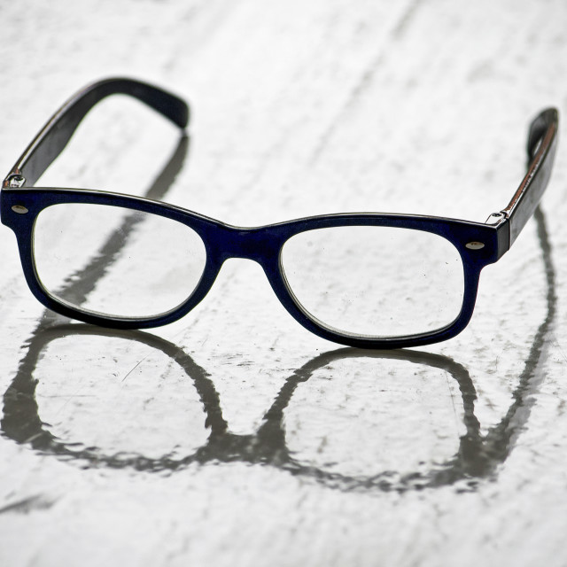 """Reading glasses reflected"" stock image"
