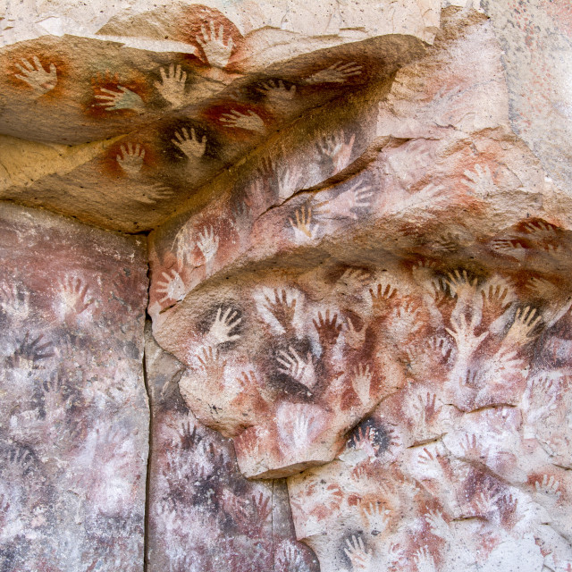 """Colourful handprints on a rock face, ochre-ink art made by the long-vanished..."" stock image"