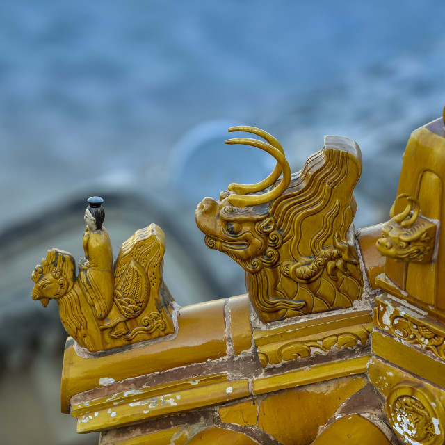 """Detail of figures on a roof in The Summer Palace; Beijing, China"" stock image"
