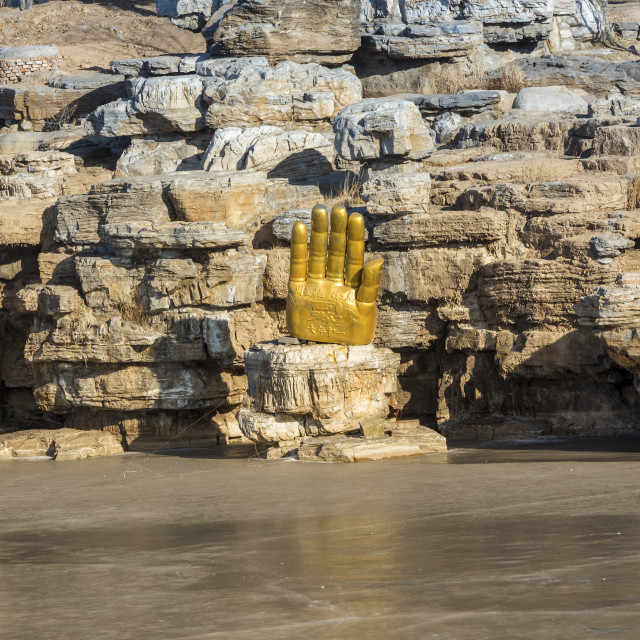 """Buda hand along the frozen lake at Yungang Grottoes, ancient Chinese Buddhist..."" stock image"