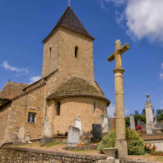 """Medieval church and churchyard"" stock image"