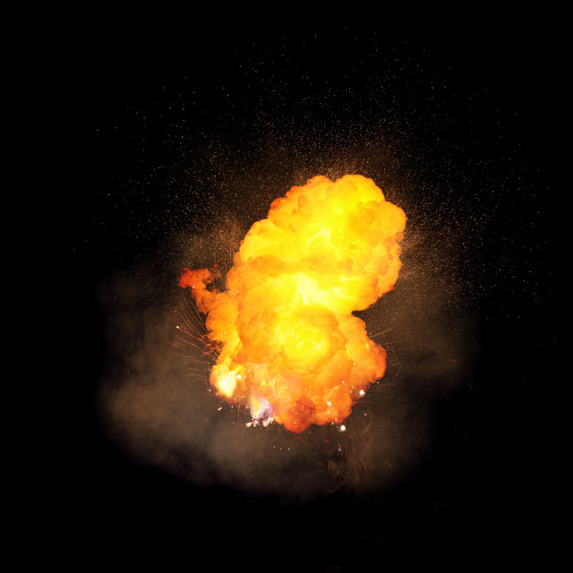 """Realistic fiery explosion, orange color with sparks and smoke isolated on black background"" stock image"