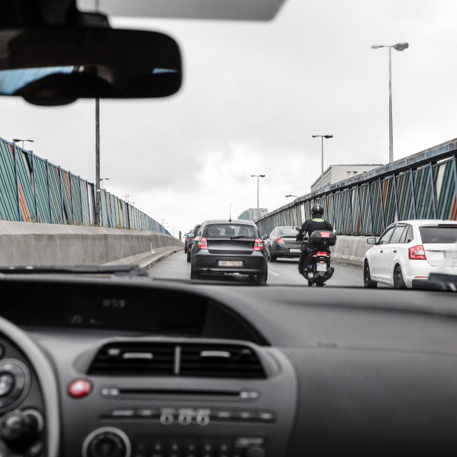 """Driving a passenger car in traffic jam, view from inside on crowded road"" stock image"