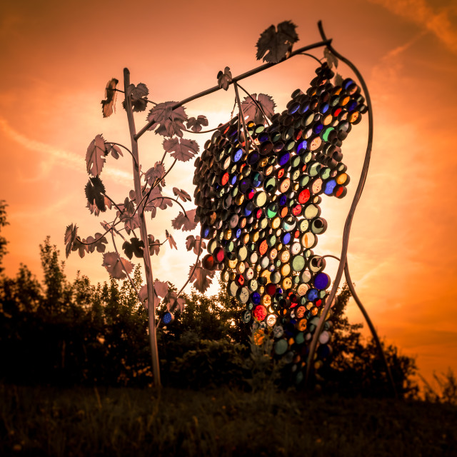 """Glass Bunch of grapes by artist Willibald Trojan on Eorykogel, Glanz an der Weinstrasse, Styria, Austria, Europe"" stock image"