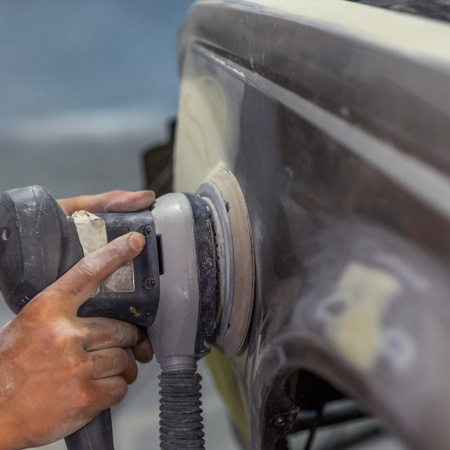 """""""Mechanic working in auto shop."""" stock image"""