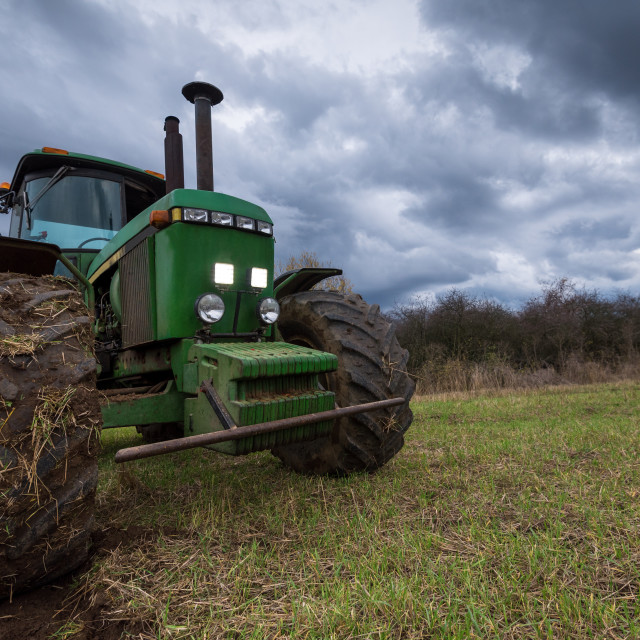"""""""Tractor plowing fields."""" stock image"""