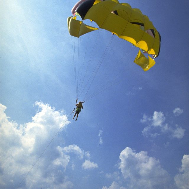 """Parasailing into the Sun on Lake of the Ozarks"" stock image"