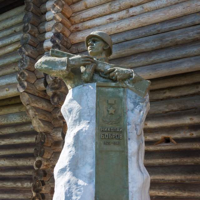 """""""Monument to soldier Nikolai Bobrov at the walls of an ancient fo"""" stock image"""