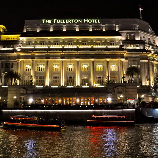 """""""Fullerton Hotel, Singapore at night"""" stock image"""