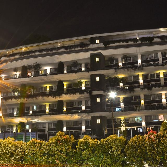 """Modern apartment block at night"" stock image"