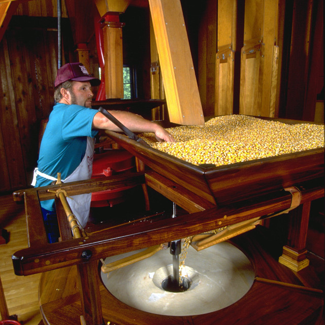 """Grist Mill Grinding Corn"" stock image"