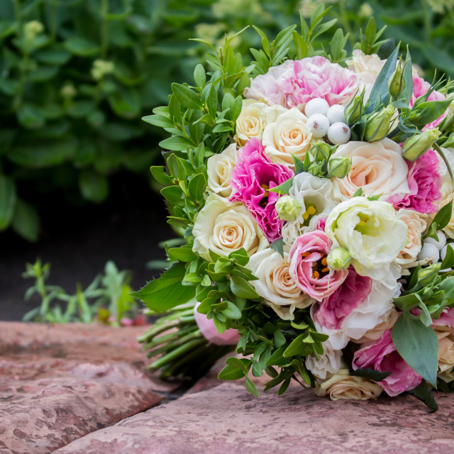 """""""Close-up of groom's hand holding bride's wirst tender, flower, newlywed, church"""" stock image"""