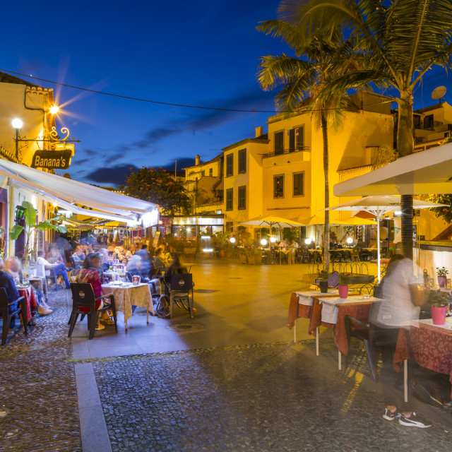 """""""View of cafe in cobbled street in old town at dusk, Funchal, Madeira,..."""" stock image"""