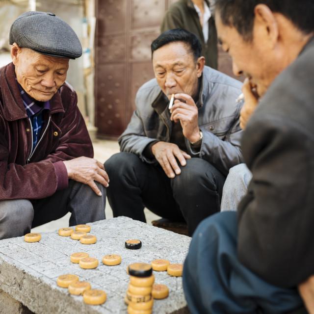 """Men playing traditional game of Xiangqi (Chinese Chess), Dali, Yunnan..."" stock image"