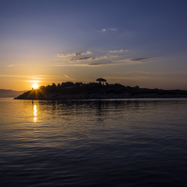 """Sunrise over the Greek Mainland & Panagia from Paxos."" stock image"