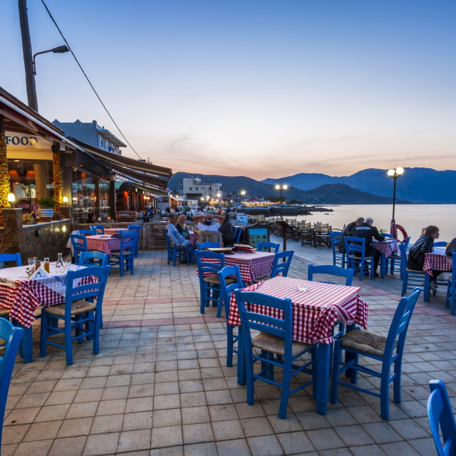 """Traditional Cretan Food Restaurant at Paraliaki promenaad at sunset in..."" stock image"