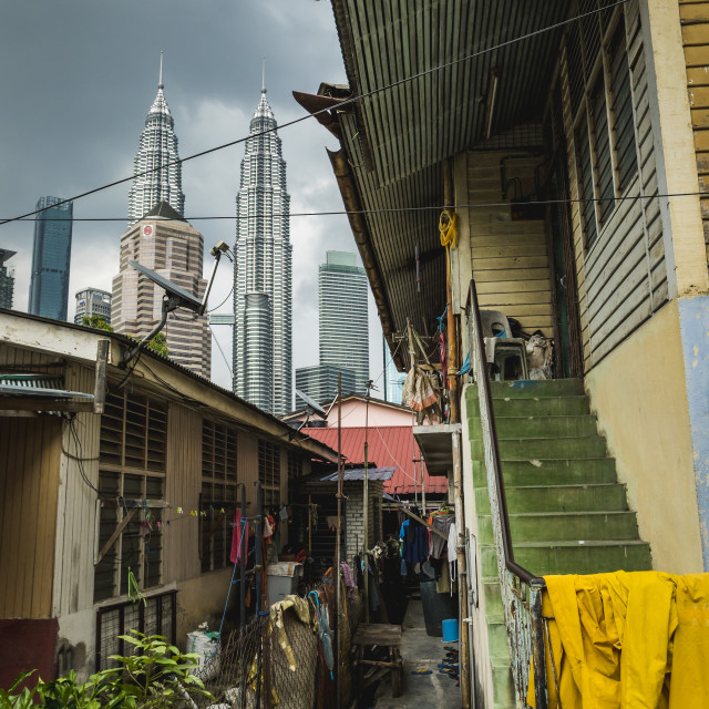"""Alley in Kampung Baru with the Petronas Twin Towers in the background"" stock image"
