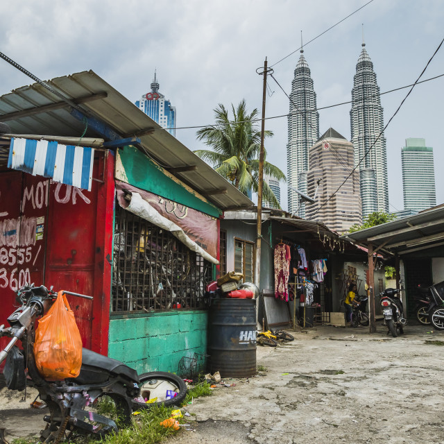 """Side street in Kampung Baru with the Petronas Twin Towers in the background"" stock image"
