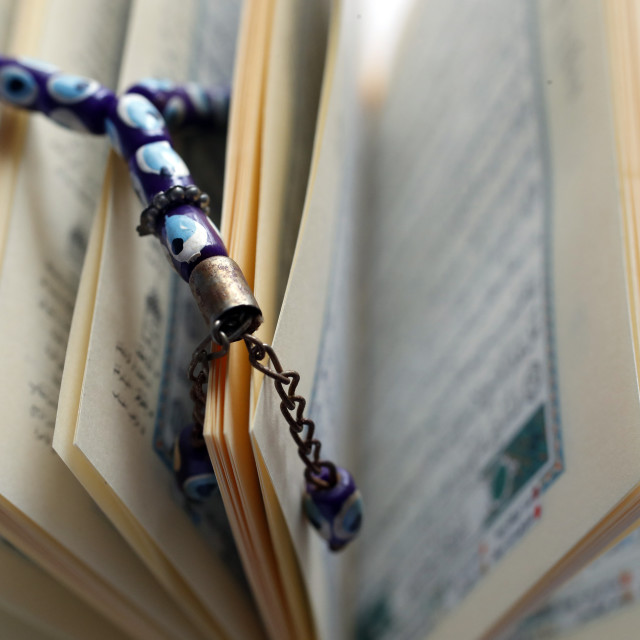 """""""Arabic Holy Quran and a prayer beads."""" stock image"""