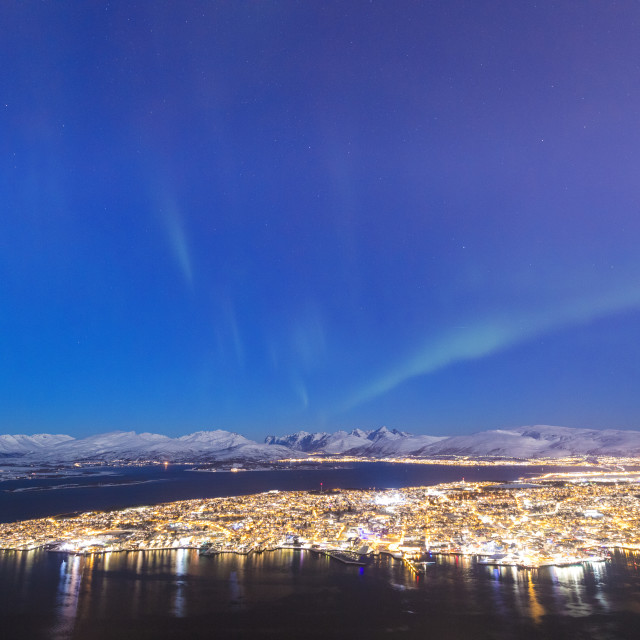 """Northern Lights on the city of Troms seen from Fjellheisen, Troms county, Norway"" stock image"
