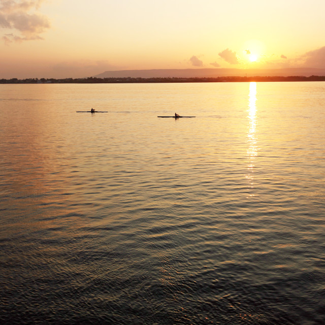 """Canoeists at sunset, Ortigia, Sicily, Italy"" stock image"