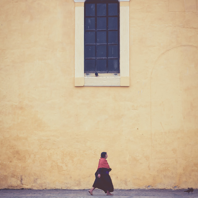 """A woman walking under a window in mexico"" stock image"