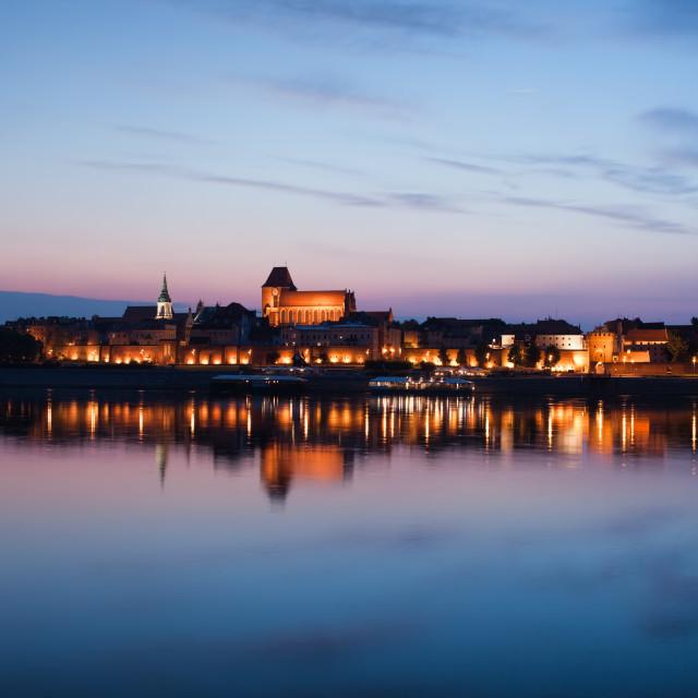 """City Skyline of Torun at Dusk in Poland"" stock image"