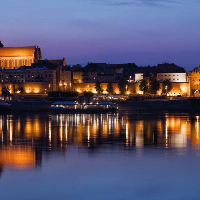 """Night City Skyline of Torun from Vistula River"" stock image"
